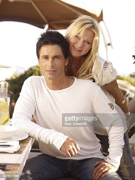 Rob Lowe and his wife Sheryl Lowe pose on the patio of their beach house on September 5 in Santa Barbara California All men's and women's jewelry by...