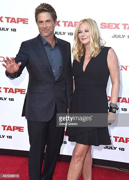 Rob Lowe and Sheryl Berkoff arrives at the Sex Tape Los Angeles Premiere at Regency Village Theatre on July 10 2014 in Westwood California