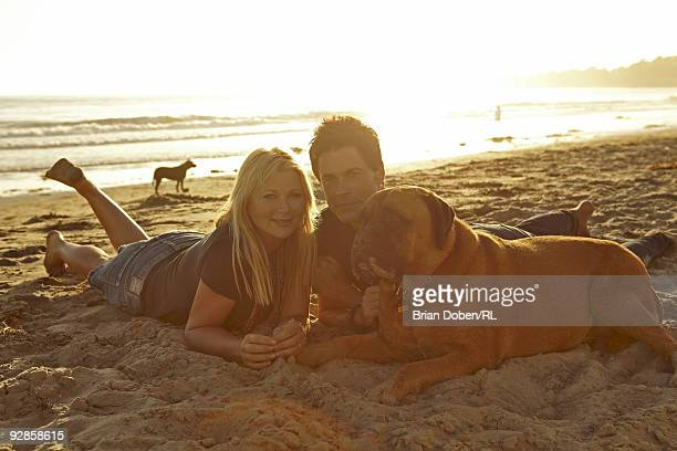Rob Lowe his wife Sheryl Lowe and their dog Ruby relax on the beach near their home on September 5 in Santa Barbara California All men's and women's...