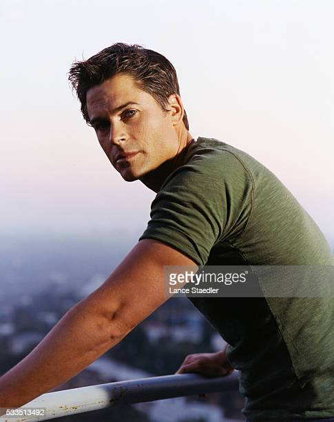 Rob Lowe Leaning on a Railing