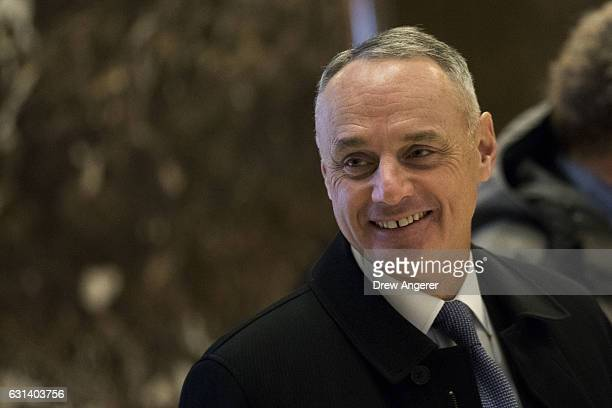 Rob Manfred Commissioner of Major League Baseball arrives at Trump Tower January 10 2017 in New York City Presidentelect Donald Trump and his...
