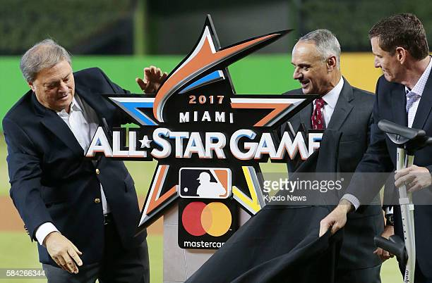 Rob Manfred commissioner of Major League Baseball unveils the logo for the 2017 MLB AllStar Game before a game between the Miami Marlins and the...