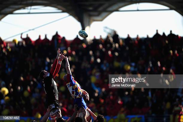 Rob McCusker of Scarlets jumps in the line out with Damien Chouly of Perpignan during the Heineken Cup Pool 5 match between Perpignan and Scarlets at...