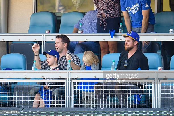 Rob McElhenney Axel Lee McElhenney and Leo Grey McElhenney attend a baseball game between the Washington Nationals and Los Angeles Dodgers at Dodger...
