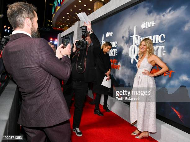 Rob McElhenney take picture of spouse Kaitlin Olson at the Premiere of Apple TV's Mythic Quest Raven's Banquet at The Cinerama Dome on January 29...
