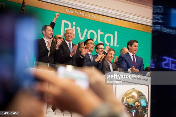 Rob Mee chief executive officer of Pivotal Software Inc center right rings the opening bell during the company's initial public offering on the floor...
