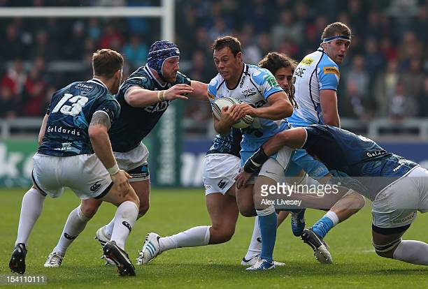 Rob Miller of Sale Sharks is tackled by Lou Reed of Cardiff Blues during the Heineken Cup Pool 6 match between Sale Sharks and Cardiff Blues at...