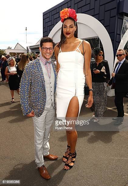 Rob Mills and Liz Cambage pose on Melbourne Cup Day at Flemington Racecourse on November 1 2016 in Melbourne Australia