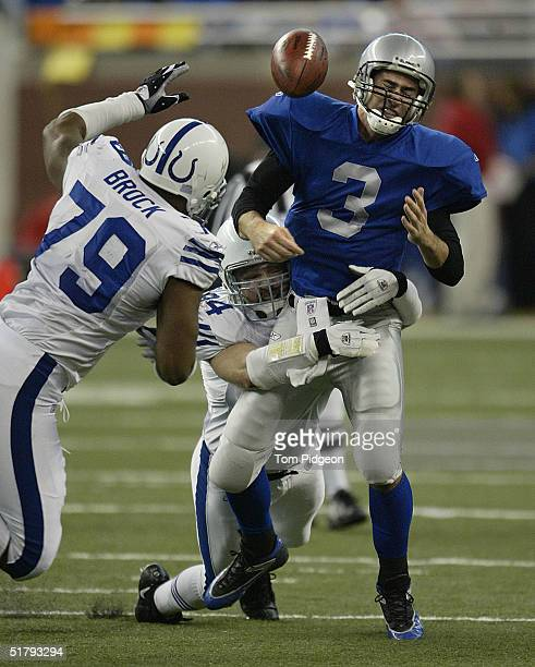 Rob Morris of the Indianapolis Colts sacks Joey Harrington of the Detroit Lions causing a fumble recovered by The Colts at Ford Field on November 25...