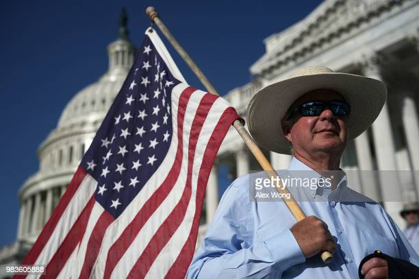 Rob Morrison of Heart Mountain Wyoming holds a US flag during a rally in front of the US Capitol June 25 2018 on Capitol Hill in Washington DC Common...