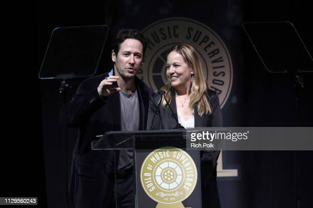 Rob Morrow and Robin Urdang speak onstage during the 9th Annual Guild of Music Supervisors Awards on February 13 2019 at The Theatre at Ace Hotel in...
