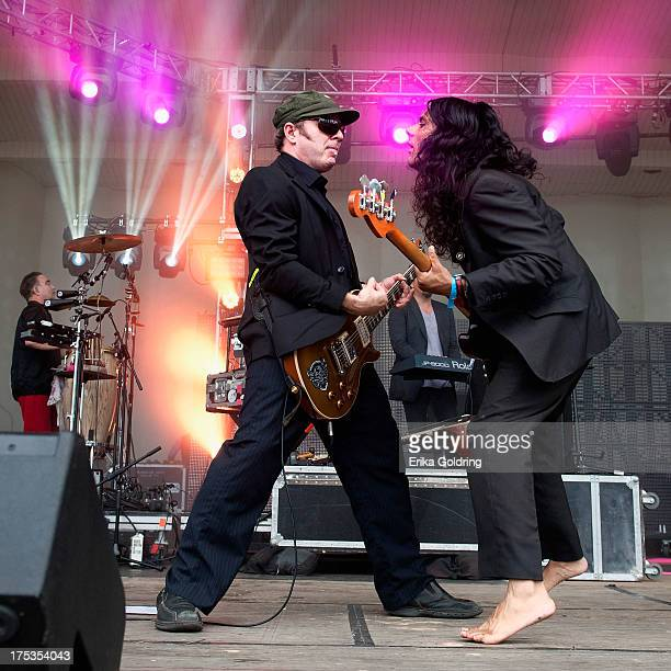 Rob Myers and Ashish Vyas of Thievery Corporation perform during Lollapalooza 2013 at Grant Park on August 2 2013 in Chicago Illinois