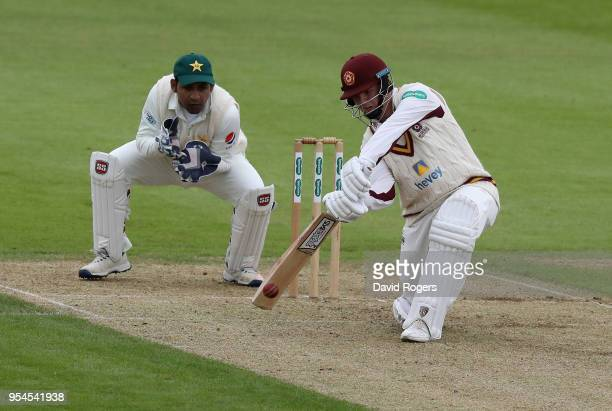 Rob Newton of Northamptonshire drives the ball during the tour match between Northamptonshire and Pakistan at The County Ground on May 4 2018 in...