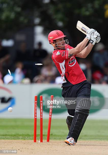Rob Nicol of Canterbury is bowled by Michael Bates of Auckland during the HRV Cup match between the Auckland Aces and Canterbury Wizards at Colin...