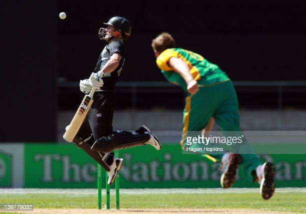 Rob Nicol of New Zealand avoids a bouncer during the One Day International match between New Zealand and South Africa at Westpac Stadium on February...