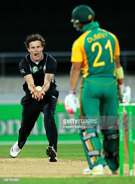Rob Nicol of New Zealand takes a catch off his own bowling to dismiss JP Duminy of South Africa during the One Day International match between New...