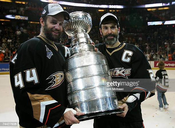 Rob Niedermayer of the Anaheim Ducks and brother Scott Niedermayer pose with the Stanley Cup after their team's victory over the Ottawa Senators in...