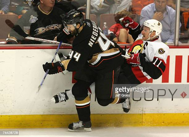 Rob Niedermayer of the Anaheim Ducks checks Daniel Alfredsson of the Ottawa Senators during Game Five of the 2007 Stanley Cup finals on June 6 2007...