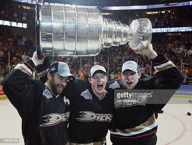 Rob Niedermayer, Samuel Pahlsson and Travis Moen of the Anaheim Ducks celebrate winning the Stanley Cup after defeating the Ottawa Senators in Game...