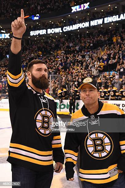 Rob Ninkovich and President Jonathan Kraft of the New England Patriots acknowledge the crowd from the ice before the game of the Boston Bruins...