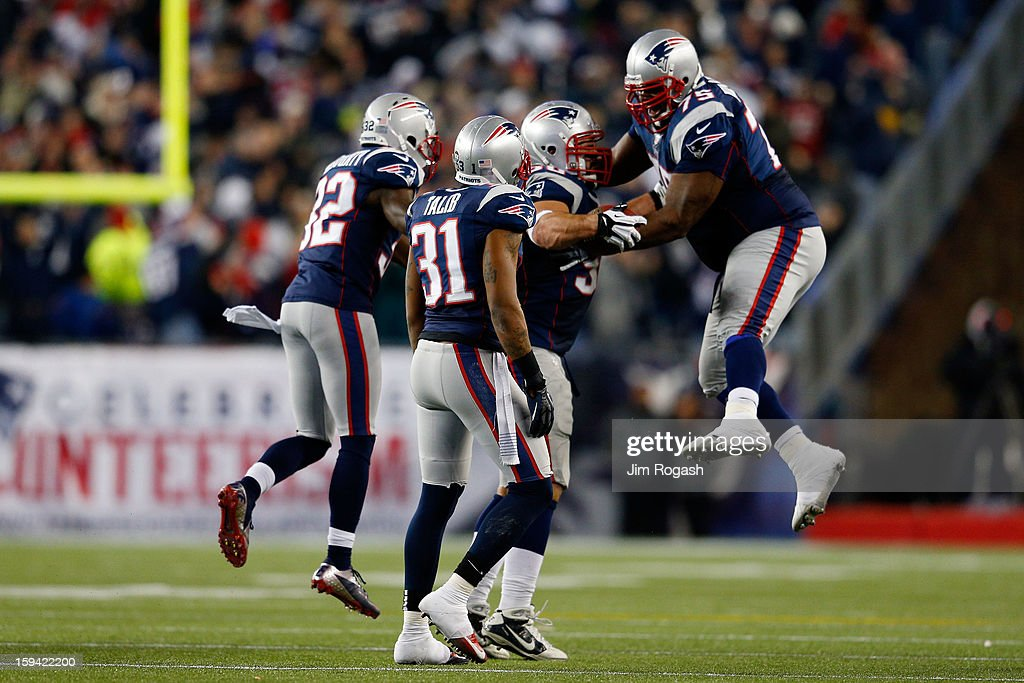 Rob Ninkovich #50 of the New England Patriots celebrates with Vince Wilfork #75, Aqib Talib #31 and Devin McCourty #32 after making an interception in the third quarter against the Houston Texans during the 2013 AFC Divisional Playoffs game at Gillette Stadium on January 13, 2013 in Foxboro, Massachusetts.