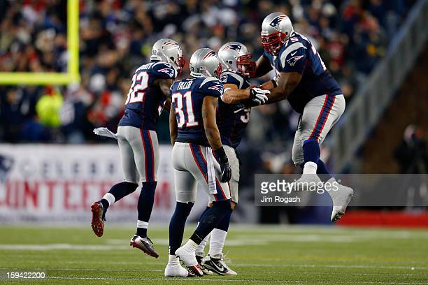 Rob Ninkovich of the New England Patriots celebrates with Vince Wilfork Aqib Talib and Devin McCourty after making an interception in the third...