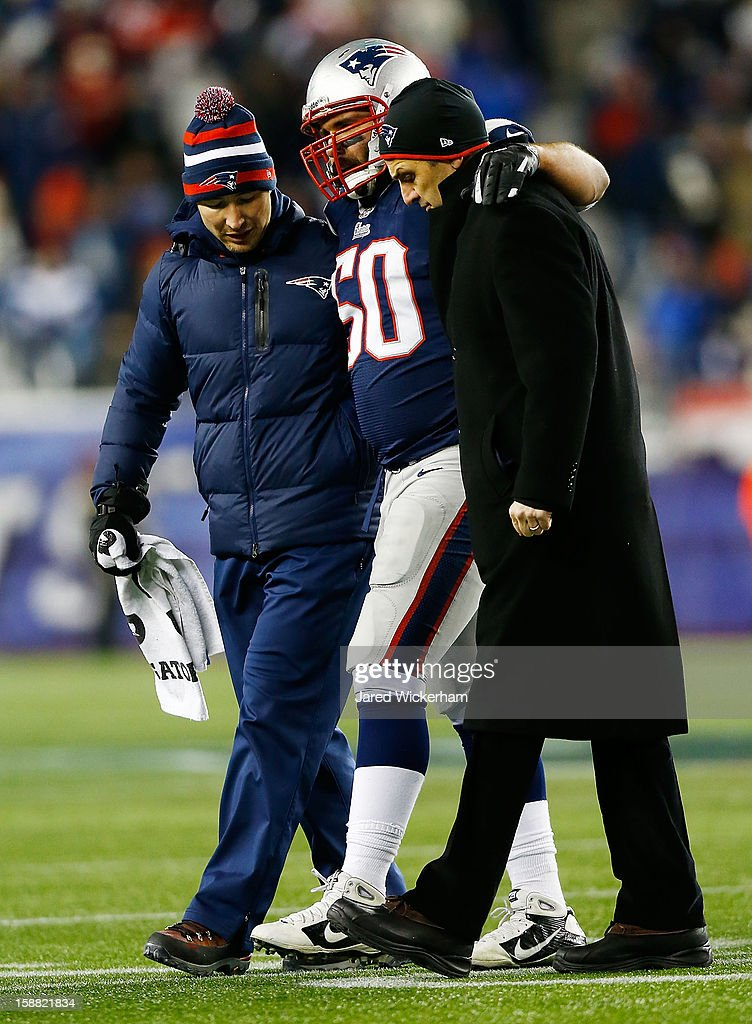 Rob Ninkovich #50 of the New England Patriots is helped off of the field after being injured against the Miami Dolphins during the game at Gillette Stadium on December 30, 2012 in Foxboro, Massachusetts.