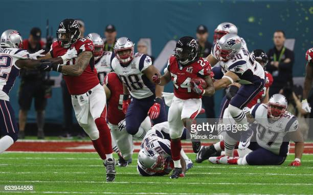 Rob Ninkovich of the New England Patriots reaches to tackle Devonta Freeman of the Atlanta Falcons during the first quarter of Super Bowl 51 at NRG...