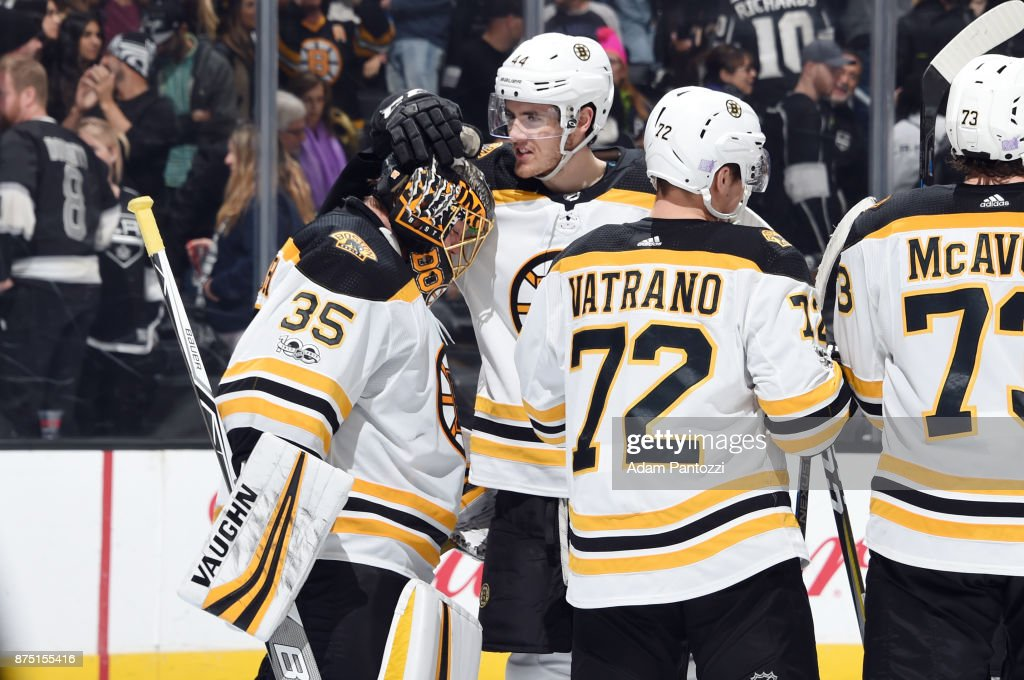 Rob O'Gara #44 and Anton Khudobin #35 of the Boston Bruins celebrate a victory over the Los Angeles Kings at STAPLES Center on November 16, 2017 in Los Angeles, California.