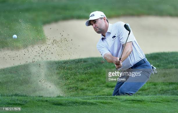 Rob Oppenheim hits out of a bunker on the 16th hole during the third round of the WinCo Foods Portland Open presented by KraftHeinz at Pumpkin Ridge...