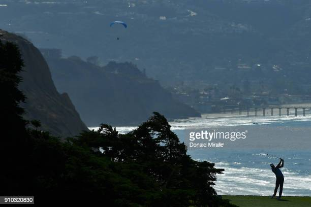 Rob Oppenheim plays his shot from the 16th tee with Ellen Browning Scripps Memorial Pier in the background during the first round of the Farmers...