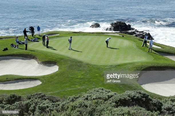 Rob Oppenheim putts on the seventh green during the Final Round of the ATT Pebble Beach ProAm at Pebble Beach Golf Links on February 12 2017 in...