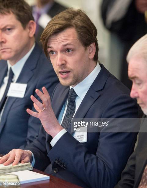 Rob Opsomer from the Ellen MacArthur foundation responds to Prince Charles Prince of Wales as they attend a meeting of key plastics stakeholders and...