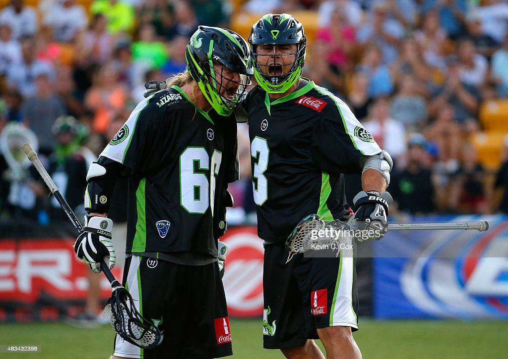 Rob Pannell #3 of the New York Lizards celebrates scoring a goal against the Rochester Rattlers with Matt Gibson #66 during the 2015 Major League Lacrosse Championship Game at Fifth Third Bank Stadium on August 8, 2015 in Kennesaw, Georgia.