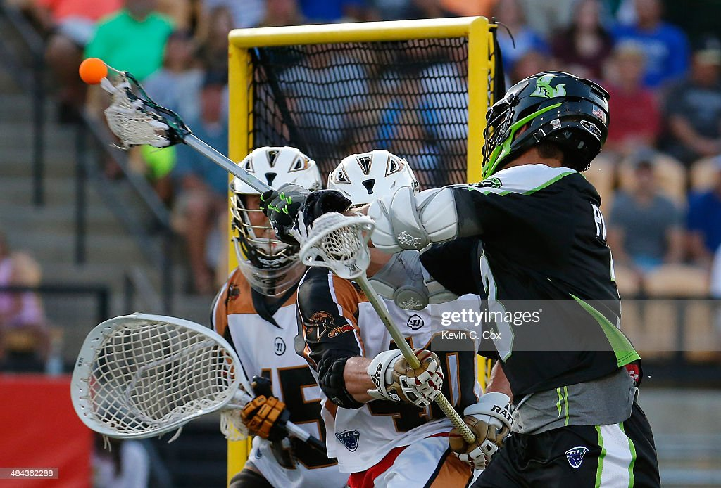 Rob Pannell #3 of the New York Lizards scores against John Galloway #15 and John Lade #40 of the Rochester Rattlers during the 2015 Major League Lacrosse Championship Game at Fifth Third Bank Stadium on August 8, 2015 in Kennesaw, Georgia.