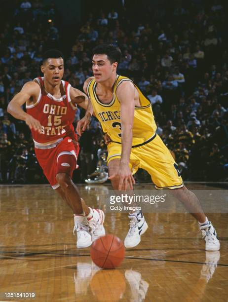 Rob Pelinka, Guard for the University of Michigan Wolverines dribbles the ball past Jamie Skelton, Guard for the Ohio State Buckeyes during their...
