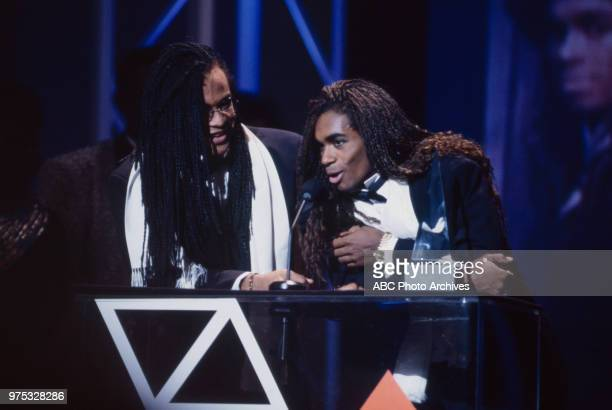 Rob Pilatus Fab Morvan Milli Vanilli receiving award on the 17th Annual American Music Awards Shrine Auditorium January 22 1990