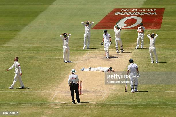 Rob Quiney of Australia lays on the pitch after attempting to catch out Faf du Plesis of South Africa off a delivery by captain Michael Clarke during...