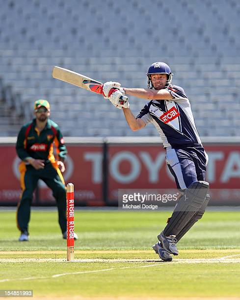 Rob Quiney of the Bushrangers bats and hits a boundary during the Ryobi One Day Cup match between Victorian Bushrangers and the Tasmanian Tigers at...