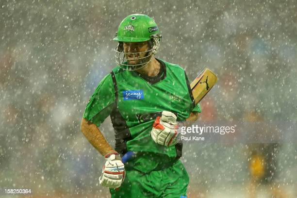 Rob Quiney of the Stars heads from the field as heavy rain sets in during the Big Bash League match between the Perth Scorchers and the Melbourne...