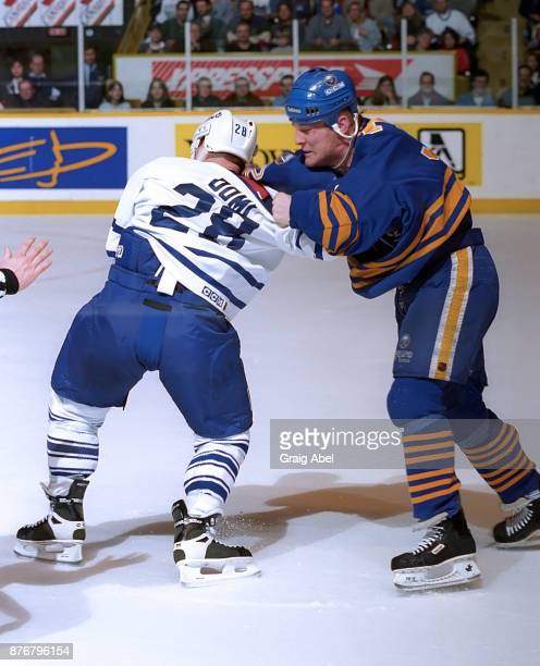 Rob Ray of the Buffalo Sabres battles with Tie Domi of the Toronto Maple Leafs during NHL game action on February 10 1996 at Maple Leaf Gardens in...
