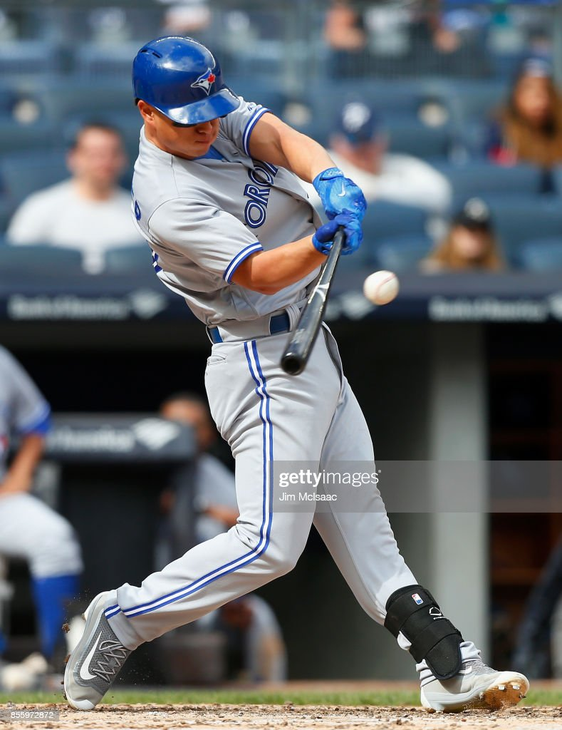 Rob Refsnyder #39 of the Toronto Blue Jays connects on a base hit in the third inning against the New York Yankees at Yankee Stadium on September 30, 2017 in the Bronx borough of New York City.