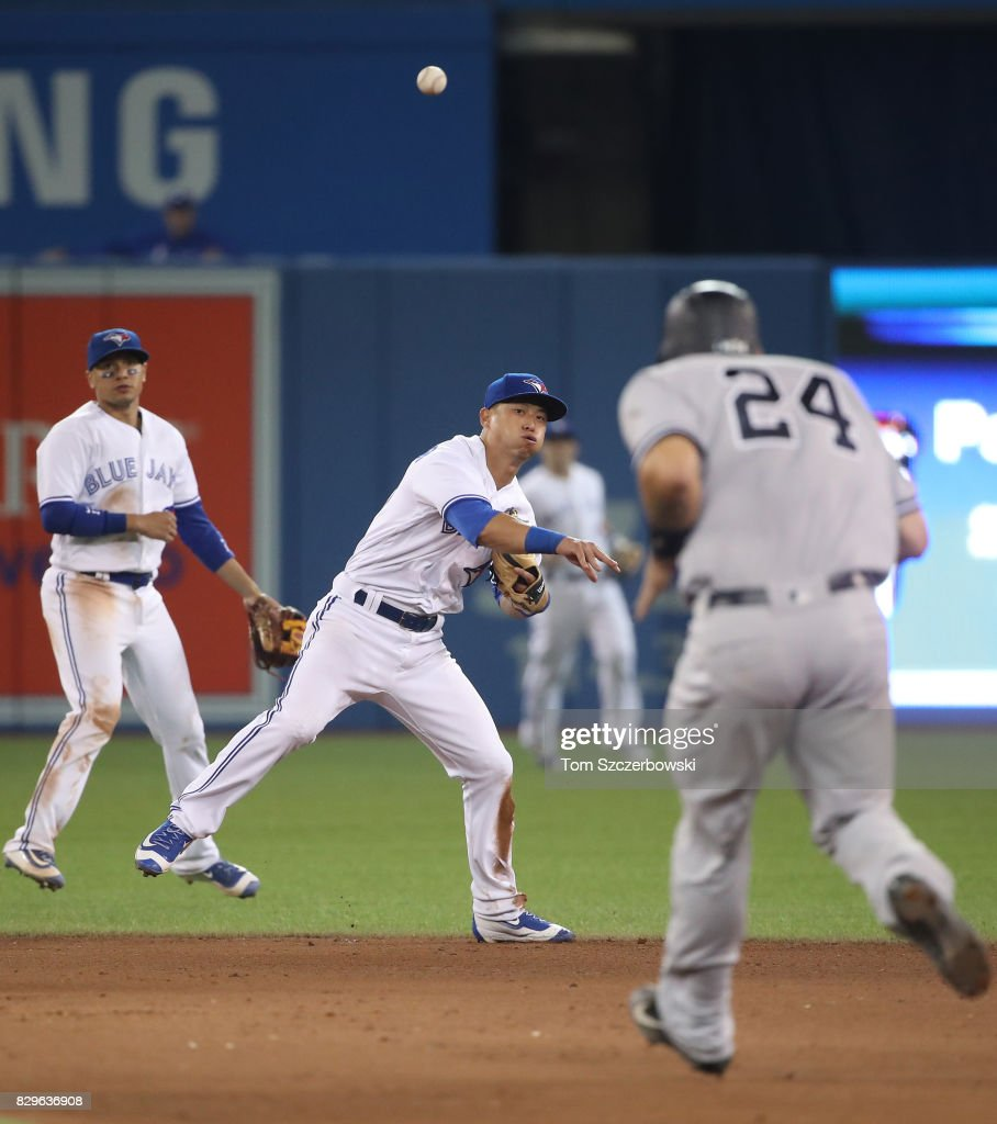 Rob Refsnyder #39 of the Toronto Blue Jays makes the play and throws out the baserunner in the eighth inning during MLB game action against the New York Yankees at Rogers Centre on August 10, 2017 in Toronto, Canada.
