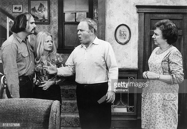 """: Rob Reiner, Sally Struthers, Carol O'Connor, and Jean Stapleton in a scene from the T.V. Series """"All In The Family."""" They are all standing in this..."""
