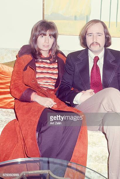 Rob Reiner sitting with his wife Penny Marshall She is wearing a rust colored suede coat circa 1970 New York