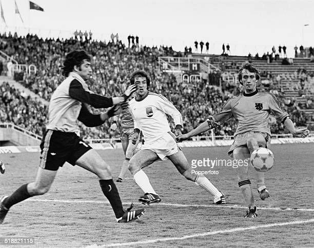 Rob Rensenbrink of the Netherlands is challenged by Iranian goalkeeper Nasser Hejazi during a World Cup group 4 match at Estadio Ciudad de Mendoza...
