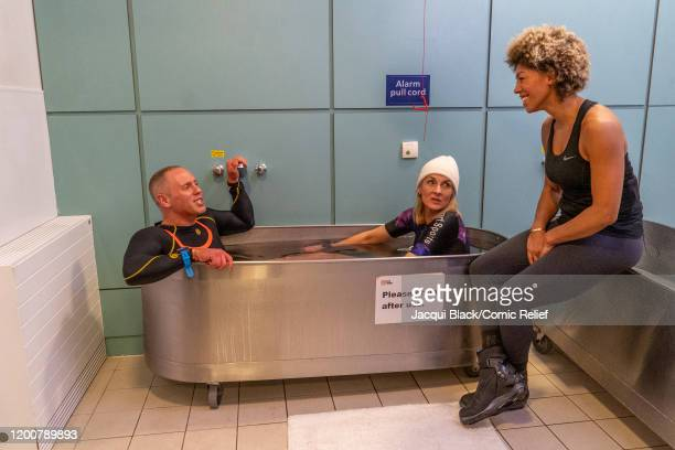 Rob Rinder and Louise Minchin step into an ice bath on February 7 2020 in London England The celebrities are training for Sport Relief On Thin Ice as...