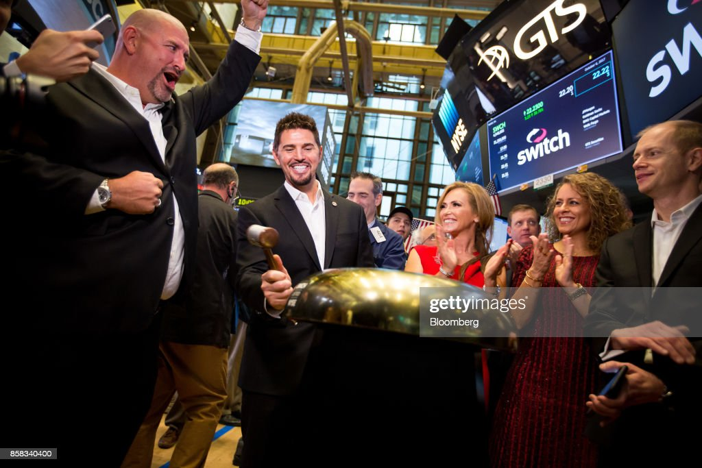 Rob Roy, founder and chief executive officer of Switch Inc., center left, rings a ceremonial bell during the company's initial public offering (IPO) on the floor of the New York Stock Exchange (NYSE) in New York, U.S., on Friday, Oct. 6, 2017. Switchjumped by almost half in its trading debut after raising $531 million in an initial public offering, the third-biggest technology IPO this year in the U.S.. Photographer: Michael Nagle/Bloomberg via Getty Images