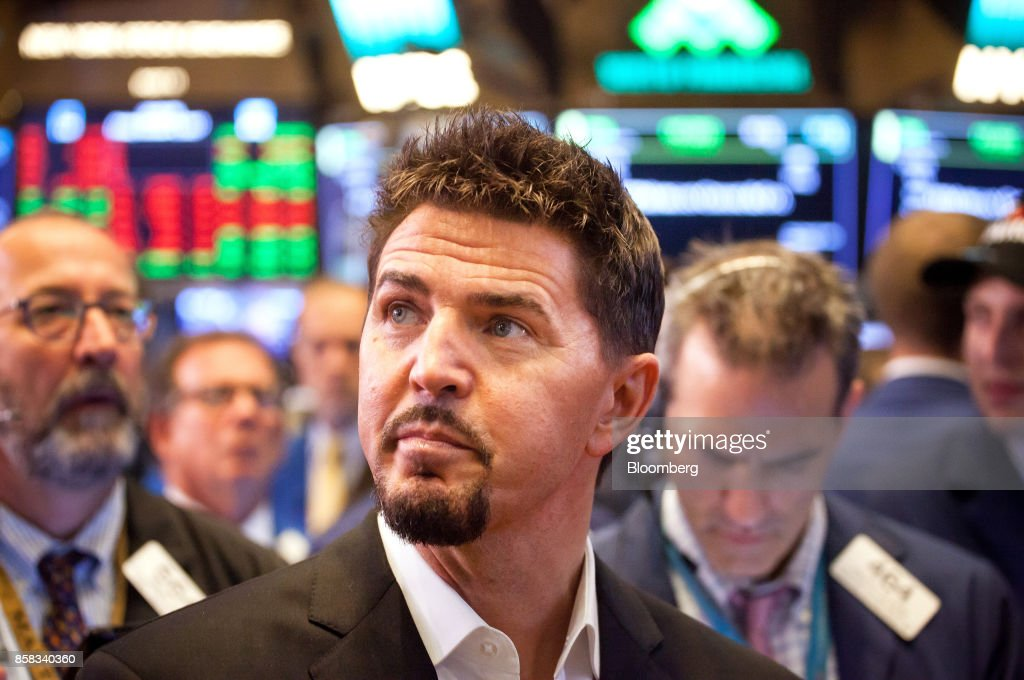 Rob Roy, founder and chief executive officer of Switch Inc., center, tours the floor of the New York Stock Exchange (NYSE) during the company's initial public offering (IPO) in New York, U.S., on Friday, Oct. 6, 2017. Switchjumped by almost half in its trading debut after raising $531 million in an initial public offering, the third-biggest technology IPO this year in the U.S.. Photographer: Michael Nagle/Bloomberg via Getty Images