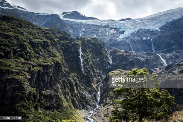 rob roy glaciar trilha panorama paisagem, wanaka, ilha sul de nova zelândia - alpes do sul da nova zelândia - fotografias e filmes do acervo